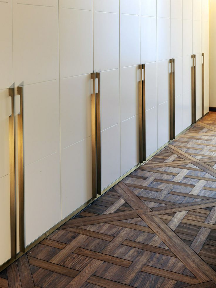 Alessia Garibaldi & Giorgio Piliego: long brass bar handles in the conference room of a notary's office in Milan
