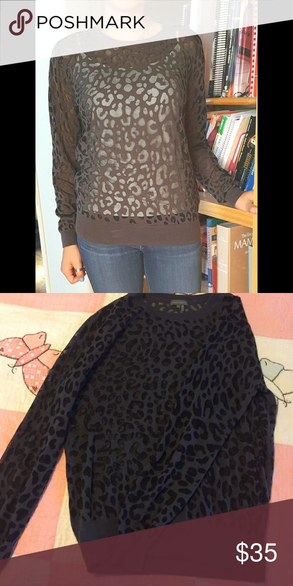 Vince Camuto Leopard top Never worn but the tags have been cut off. It is a super cute sheer Vince Camuto leopard top. Vince Camuto Sweaters