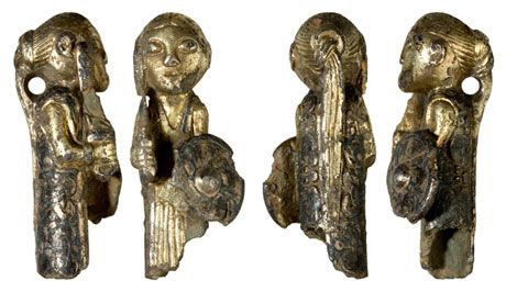 The Viking-era figure of a valkyrie found by a metal detector, near Hårby, Denmark. Four views of the Valkyrie, cleaned and to scale.