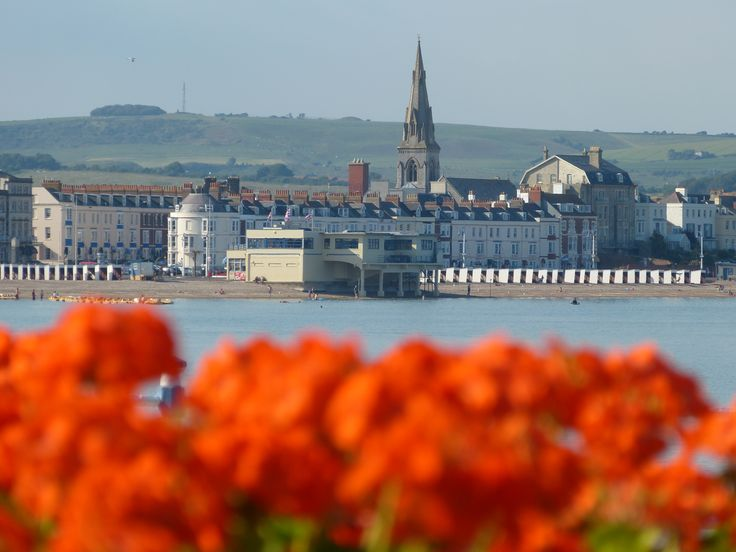 Weymouth seafront, looking north towards the Pier Bandstand and St John's Church http://www.stjohnsweymouth.co.uk/