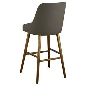 This Mid-Century Barstool from Threshold™ will become your favorite place to take a seat. Whether the kids are pulling up a chair to eat their morning cereal as you pack their lunches or you're having a quick snack, these barstools will be there for your every mealtime need. Not only are they comfy, they also add a beautiful accent to any kitchen. Durable and made to last, they add a casual and cozy look to your home. Coming in both a bar top and countertop size, choose the one t...