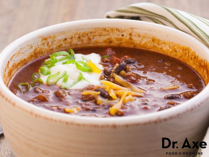 Chili in a slow cooker is a perfect and easy meal for Fall. Using grass-fed bison meat keeps this low in fat and adds extra protein. www.draxe.com