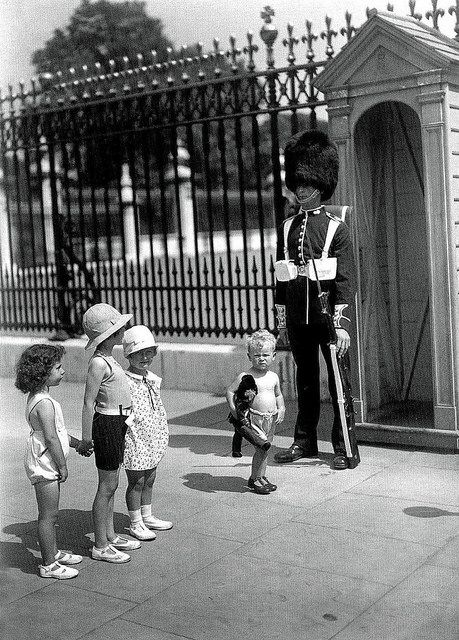 Buckingham Palace;-  Grenadier Guardsman on sentry duty outside Buckingham Palace suffers in the July 1933 heat wave.