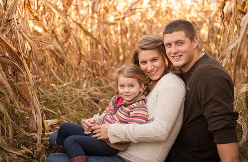 family of 3 sitting in corn maze - Tavia Larson Photography - Family, Children, and Engagement Photography - Hummelstown, PA