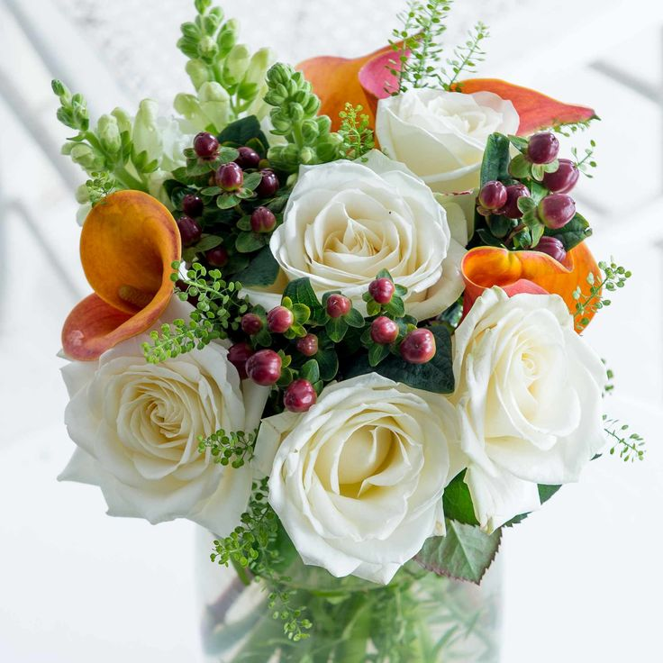 Autumn Elegance: An exquisite combination of blooms, including white snap dragons and orange calla lilies, we're certain it will delight.