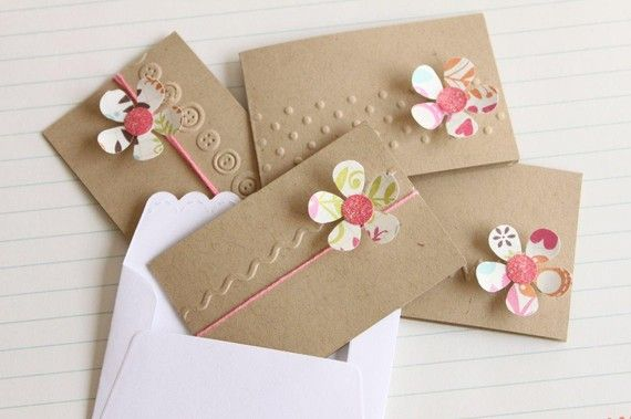 handmade notecard set ... simple and cute! ... kraft base ... boder embossing folder texture down the middle ... flower die cut from printed paper ...