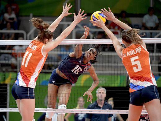 Foluke Akinradewo of the United States spikes the ball