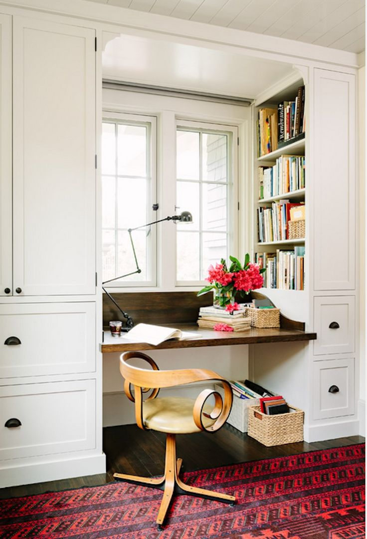 source Jessica Helgerson Interior Design website Fabulous office with builtin  cabinetry framing windows with builtin stained desk topped with an