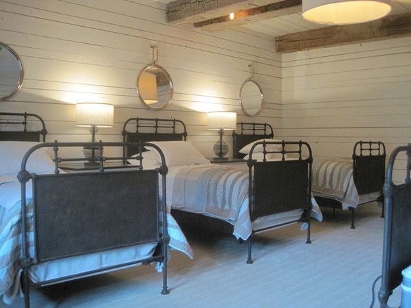 Shared children's space.  Restoration hardware beds + planking + round leather mirrors