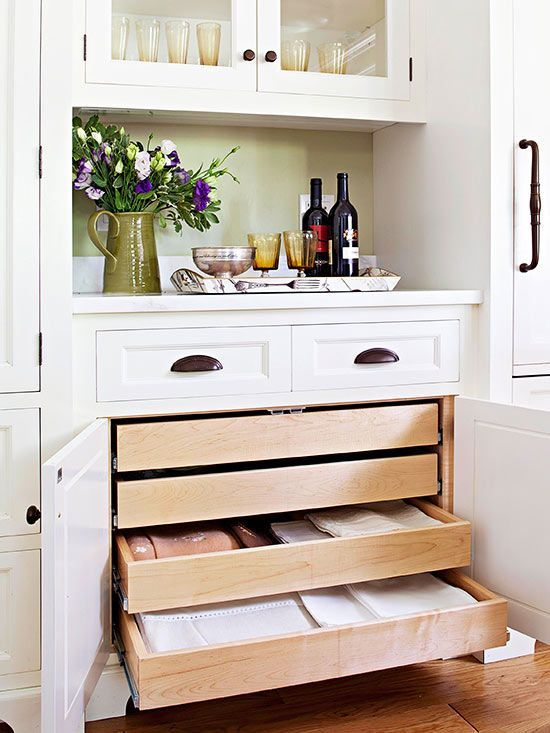 A built-in hutch is a convenient spot to store extra dishes, serving platters, and linens. Shallow drawers keep tablecloths, place mats, and napkins organized.