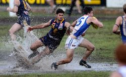 TWA-0037278 © WestPix Claremont vs East Fremantle at Claremont. 24 & 15, Thomas Willett & Brock O'Brien in the puddles.
