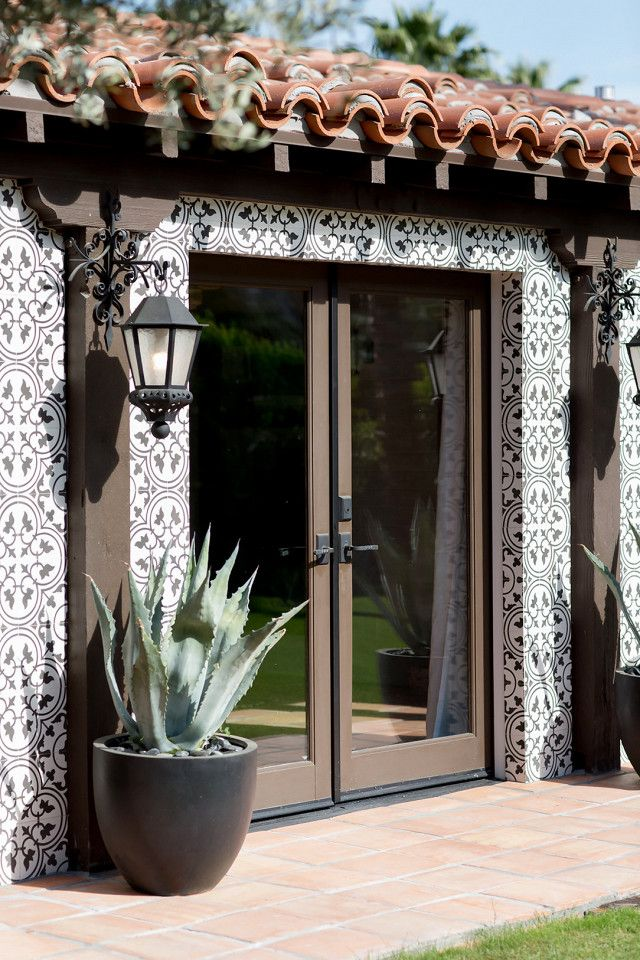 """On the exterior: """"The client had already renovated the exterior with these beautiful black-and-white cement tiles and added pale blue-green agaves in black pots to flank the..."""