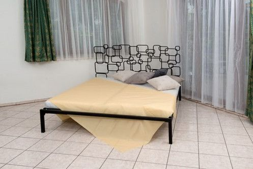 So unique and stylish it's practically a work of contemporary art, the Benedetta Bed from Beletti Design will enhance the look of any modern bedroom. This unique wrought iron headboard is made up of rectangle and square forms in an array of sizes. The geometric shapes are slightly rounded at the corners, adding to their appeal. Overlapped and stacked in some areas and sparsely staggered in others, the shapes seem randomly arranged, giving the design a playful feel.