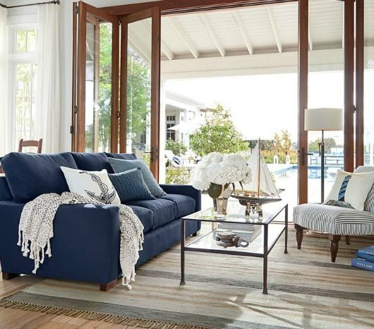 Navy Blue Sofa and Anchor Pillow.... http://www.completely-coastal.com/2017/05/navy-blue-white-stripe-living-room-bed.html