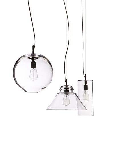 "CLEAR WINNERS    Simon Pearce's debut collection of pendant lights offers a range of spare, geometric shapes in the firm's signature blown glass. From left, the Emerson Wide pendant, $475, measures 5.5"" dia. x 12"" h.; Cavendish, $495, is 12.5"" dia. x 8"" h.; and the Hampton globe, $625, is 10"" dia. 800-774-5277; simonpearce.com"