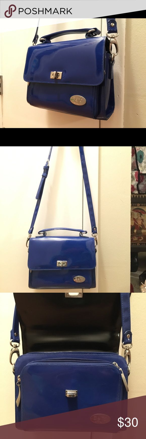 Beijo Crossbody Organizer Bag Royal blue crossbody organizer bag. It's in great condition! Carried only a few times on vacation. Strap is adjustable and there's a strap across the top to carry by hand. Beijo Bags Crossbody Bags