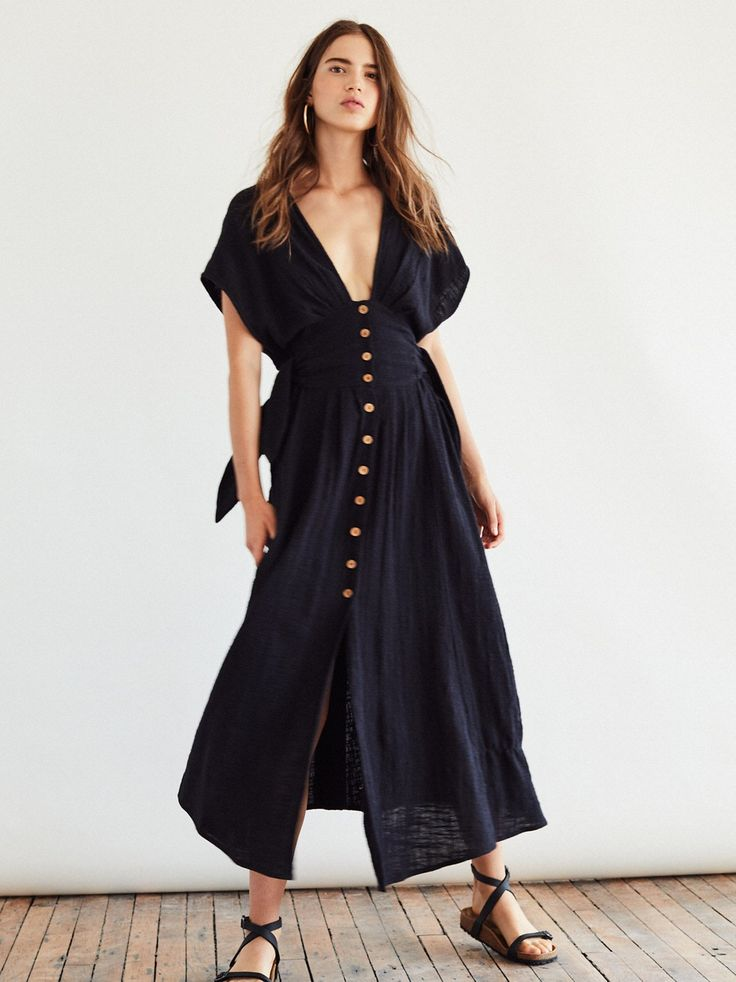 Jacinta Midi Dress | Essential dress for the season, this cotton midi dress features a breezy cotton fabric with an effortless shape, front button closures and femme side ties.    * V-neckline   * Side ties on the waist for an adjustable fit