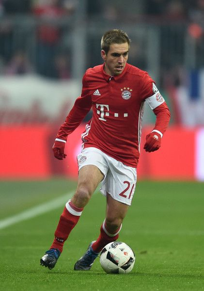 Bayern Munich's defender Philipp Lahm plays the ball during the German Cup DFB Pokal Round of 16 football match FC Bayern Munich v VFL Wolfburg in Munich, southern Germany on February 7, 2017..Germany weekly sports magazine Sports Bild reported on on February 7, 2017 Bayern Munich's defender Philipp Lahm will retire at the end of the season and also that he would not be taking the position of Sports Director at the club. / AFP / Christof STACHE / RESTRICTIONS: ACCORDING TO DFB RULES IMAGE…