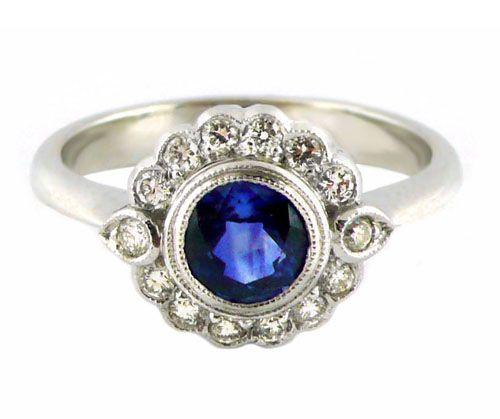 An 18ct White Gold, Blue Sapphire and Diamond Halo Ring