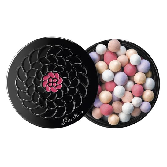 """To please loyal fans, the cult pearls offer a play on their legendary combination of six shades: beige and rosy beige to even out the skin, mauve to refresh, white to light up, gold to illuminate and pink for a healthy glow. The subtly pearly Météorites light up the face with a delicately satiny halo, discreetly perfumed with the inimitable powdery violet trail.  In a wild decoration the letters """"Champs-Élysées"""" dance in full colour, and seemingly in three dimensions, all around the bla..."""