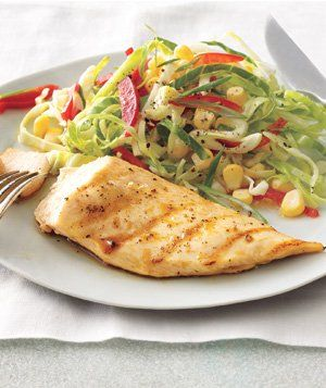 This easy, delicious recipe for Grilled Lemon Chicken With Cabbage-Corn Slaw is heart-healthy.