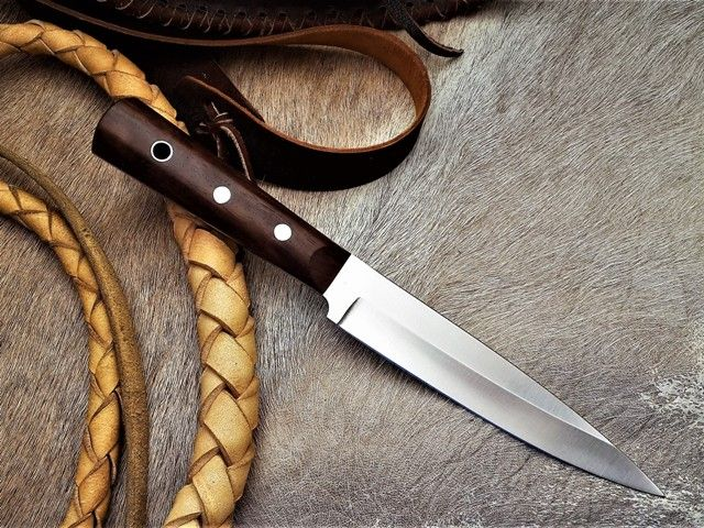 """The Wolhuter Game ranger knife, by South African knife maker Louis Naude knives. It is a legendary knife with a story. You can read the story written by the famous game ranger in his """"Memories of a game-ranger"""" by Harry Wolhuter. The knife on the picture has a Iron Wood handle. It is available from Louis Naude knives (LEO Knives).  Louis Naude knives ships worldwide."""