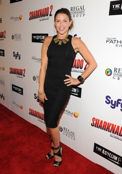 Kari Wuhrer attends the premiere of The Asylum & Fathom Events' 'Sharknado 2: The Second One' at Regal Cinemas L.A. Live on August 21, 2014 in Los Angeles, California