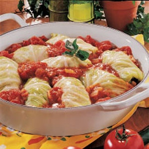 """The best part of being Ukrainian is our food:) We call these Holubtsi  but some people call them (in English) Stuffed Cabbage Rolls or Pigs in a blanket. My grandmother always made these!! Love 'em!!!""  Looks good!"