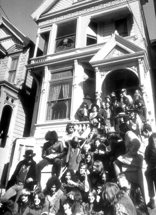 The Grateful Dead with friends outside 710 Haight Ashbury (I see Grace Slick and Jack Casady at the top right)