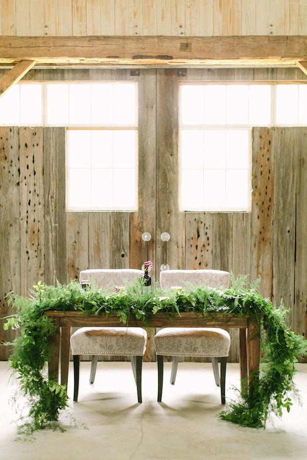 sweetheart table with fern garland | Mustard Seed Photography