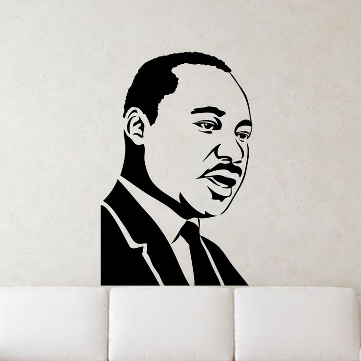 Martin Luther King Jr. Portrait Wall Decal  Never forget to dream with this elegant Martin Luther King Jr. Portrait Wall Decal. This classic portrait captures the late Dr. King mid-speech, perfect for the famous civil rights activist. Great for both educational and personal purposes, this beautiful decal will remind everyone of his timeless message of peace and equality.