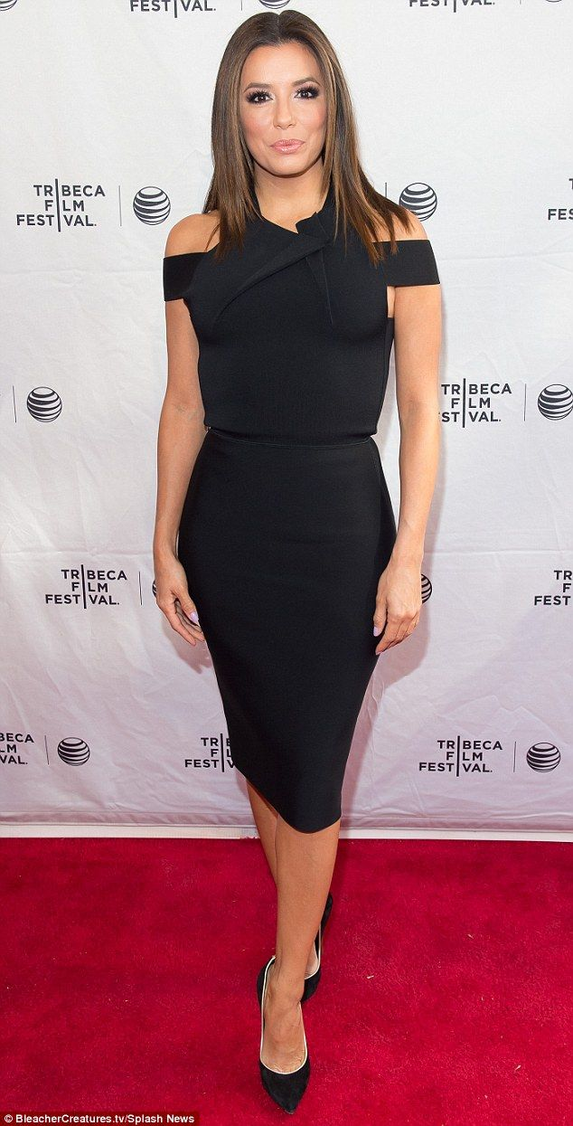 Glamour girl: Eva Longoria looked stunning in a fitted black dress that revealed just a hi...