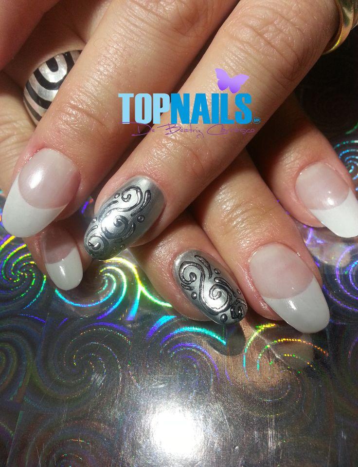 Uñas Acrílicas Pointy con aplicación de Folia Plateado. (Acrylic Nails Pointy with foil silver designs) Agregarme a tus amigas de Facebook para más información. https://www.facebook.com/topnails.acrilicas www.topnails.cl Cel:94243426, saludos Beatriz
