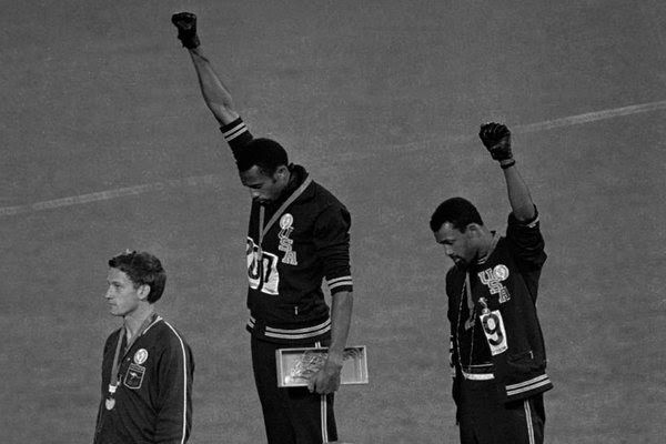 1968 The demonstration by Tommie Smith and John Carlos, who won the gold and bronze medals in the 200-meter dash, drew a quick reaction. Under pressure from the International Olympic Committee — which wanted to avoid the politicization of the Games — the U.S. team dropped the two runners, who received death threats.