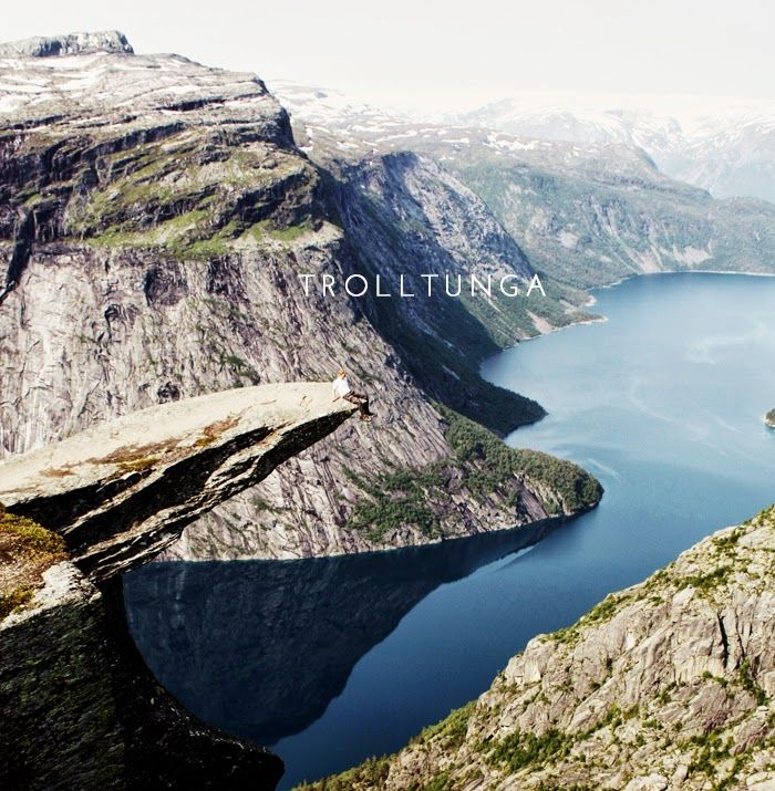 Trolltunga - a rock shelf hovering 700m above a ribbon lake