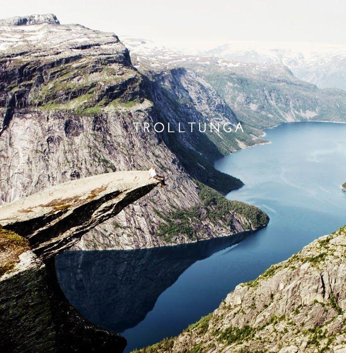 Trolltunga - a rock shelf hovering 700m above a ribbon lake