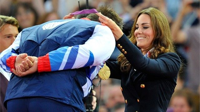 Kate presents the Gold Medal to GB athlete.