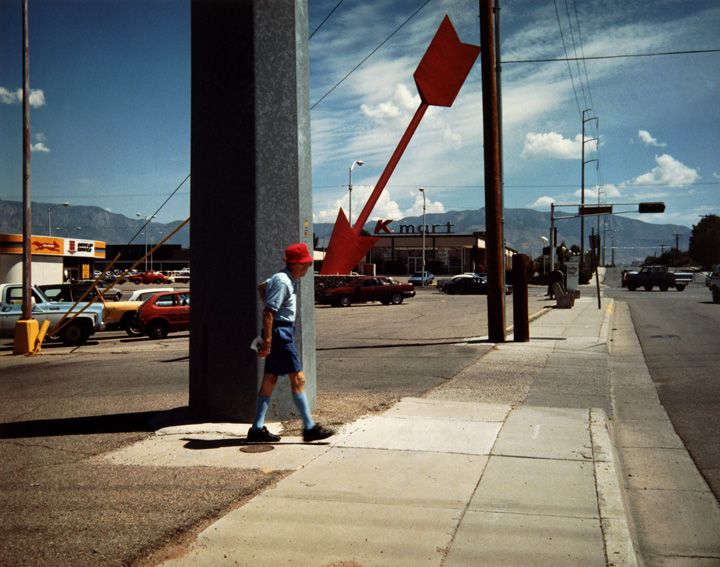 Man and red arrow | Millennium Images Library