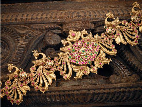 Pretty peacock design vaddanam/waist belt studded with ruby,diamond and emerald