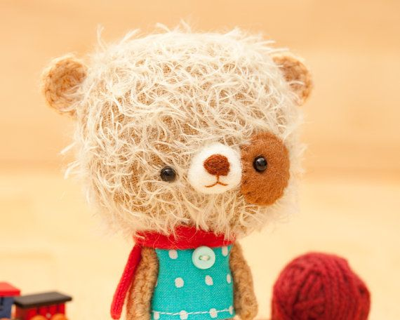 Mei is a very soft and fuzzy amigurumi crocheted and sewed stuffed teddy bear.