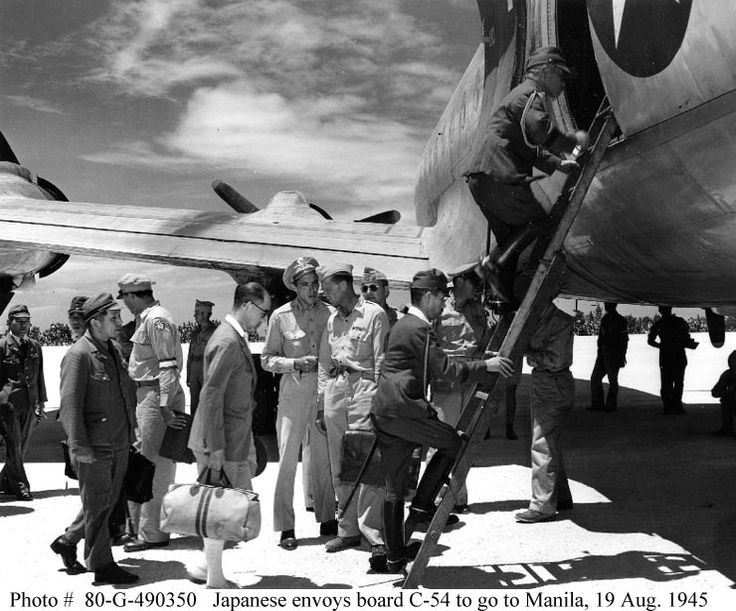 Japanese military and civilian envoys board a C-54 ...
