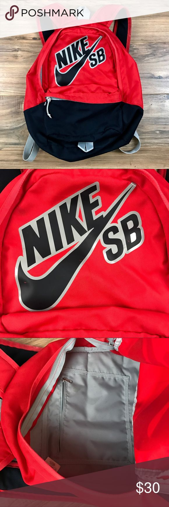 Nike SB backpack Great looking Nike SB backpack. Some minor wear on this as referenced in photos but still a lot of life left! Navy and Red Nike Bags Backpacks