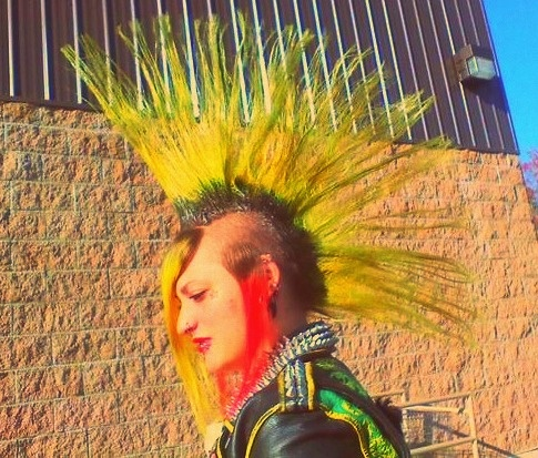 Bright yellow long fanhawk with orange side tufts and long front bangs.