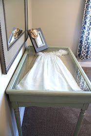Love this idea. Encase something sentimental like a christening gown in a console table.