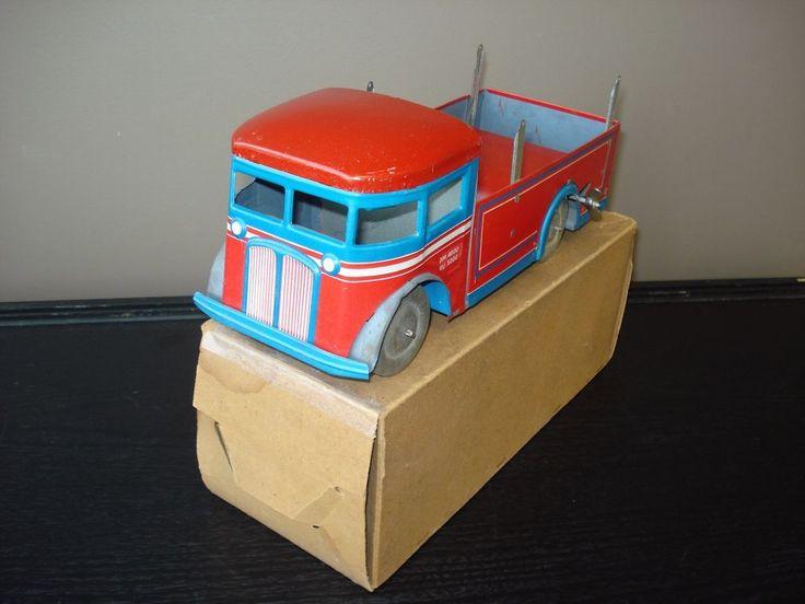 Jouet ancien camion benne mécanique tôle boîte JOUSTRA wind up truck