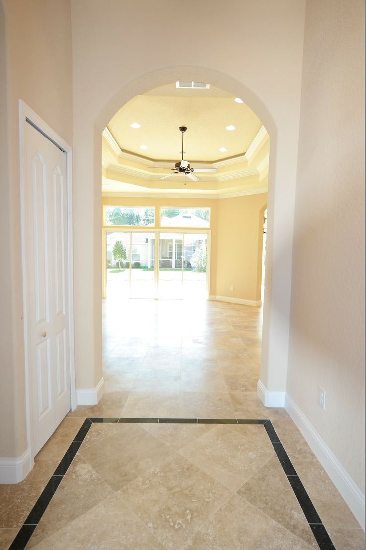 This Foyer Features A 14 39 Ceiling And Travertine Marble