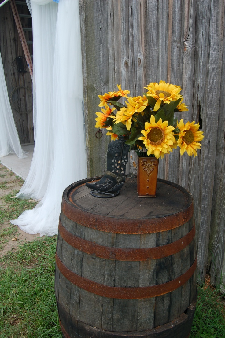 Whiskey barrel table with sunflowers | Wishing Well Barn ...