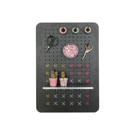 This cute metal peg board organizer is just what you need in your home to keep things running smoothly.  Use the metal kitchen organizer as a central