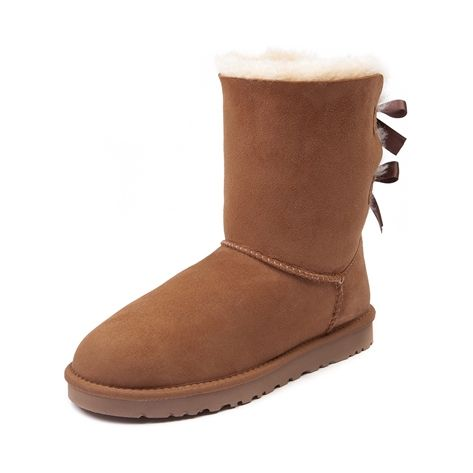 Shop for Womens UGG Bailey Bow Boot in Chestnut at Journeys Shoes. Shop today for the hottest brands in mens shoes and womens shoes at Journeys.com.The UGG® Bailey Bow boot features a decadently soft sheepskin upper, decorative double bow detail, foam cushioned footbed, and cuffable design for stylish versatility. Features a durable rubber sole and a soft fleece lining to keep feet nice and toasty! 7 12 approximate boot shaft height.