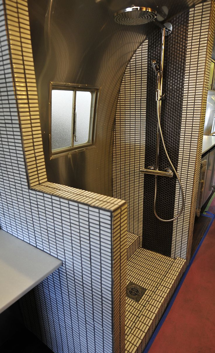 This seems like real tile, so maybe I could tile my shower? I'm concerned with the weight of a full tile shower but the current plastic has GOT to go! Open shower -makes sense (Timeless Travel Trailer 40ft Airstream Remodel) *if the shower was open....it could provide extra space for seating...dressing....